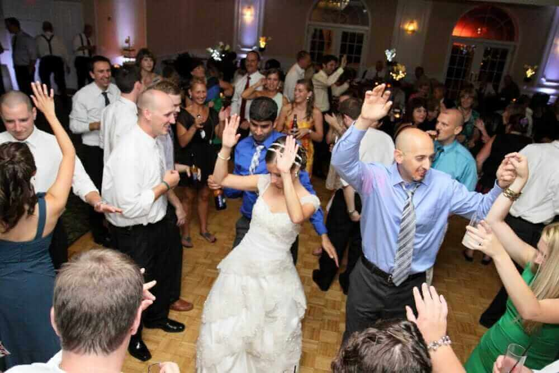 bride having fun and dancing at her wedding